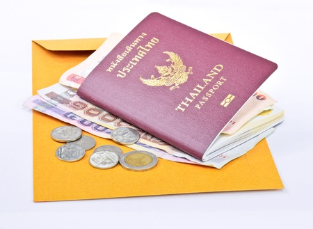 Thailand passport and Thai money on brown envelope with white background  photo