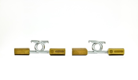 brass padlocks two pairs linked on a white background photo