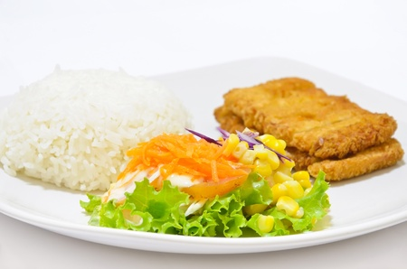 Close up vegetable salad, with fried fish and rice, on dish white. photo