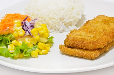 Close up, vegetable salad and Fritter Tilapia with rice on dish white  photo