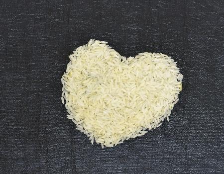 jasmine rice: Concept, Jasmine rice picture the heart on black background
