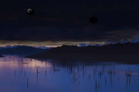 Landscape Lake with moon and a starry sky.  photo