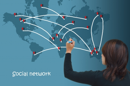 Business woman drawing social network structure in a whiteboard  photo