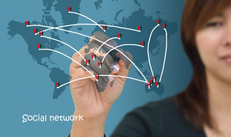 Business woman drawing social network structure in a whiteboard  Stock Photo
