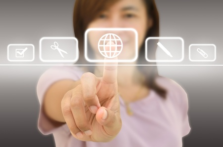 Businesswoman pressing high tech type of modern buttons on a map background Stock Photo - 11238351