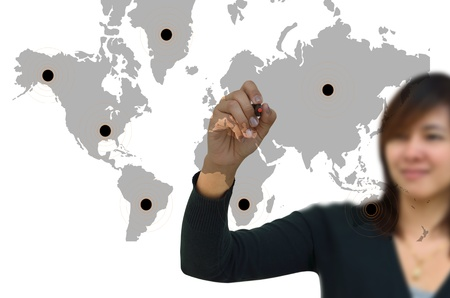 Business woman drawing network on world map  photo