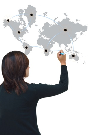 import: Business woman drawing network on world map