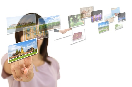 travel show: Young successful woman planning her vacations choosing options from digital touching screen