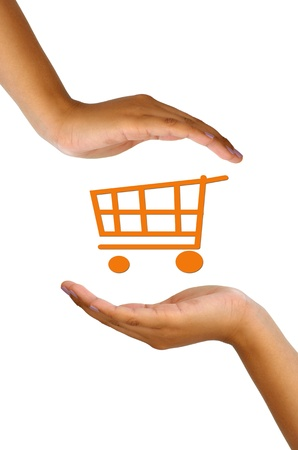 orenge: Conceptual image, help and care for green shopping. Two hands isolated on white with orenge shopping cart icon in the middle.