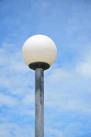 Old Fashioned Street Light against a Blue Sky  photo