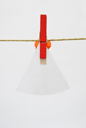 isolated note paper drying on the rope with clothes-pin   photo