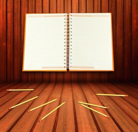 Blank White notebook on Oak wood background Horizontal  photo