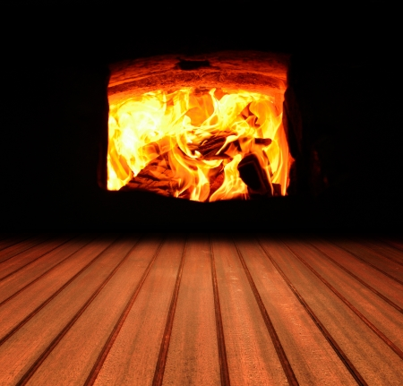 Warm Winter Fire with wood, flames, ash, embers and charcoal  Stock Photo