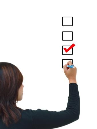 Businesswoman hand choose check mark on box