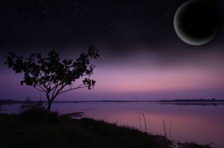 Landscape lake with moon and a starry sky  photo
