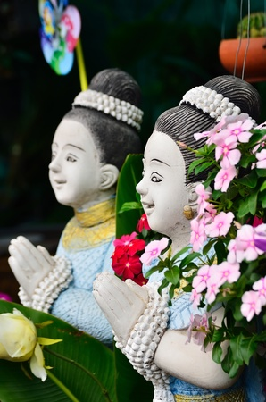 Sawasdee  which mean Hello and welcome in Thailand , sculptures in garden  photo