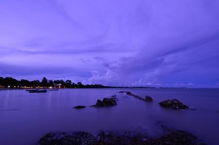nightfall: twilight and lighting on sea in thailand