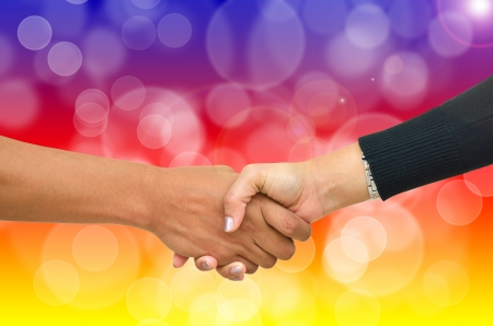 Beautiful bokeh with shaking hands two business people photo