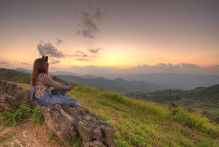 Woman sitting viewpoint beautiful mountain at Doi-Pha-Tang Chiang rai , northern Thailand HDR Stock Photo - 16930923