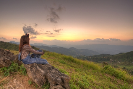 Woman sitting viewpoint beautiful mountain at Doi-Pha-Tang Chiang rai , northern Thailand HDR