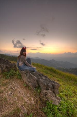 Woman sitting viewpoint beautiful mountain at Doi-Pha-Tang Chiang rai Stock Photo - 16930924