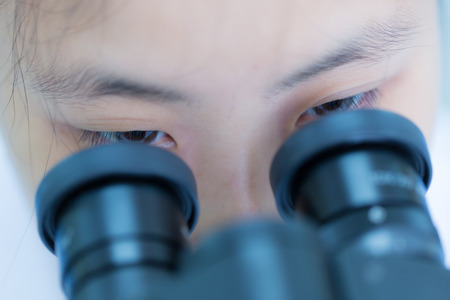 indigenous medicine: Student working with a microscope Stock Photo