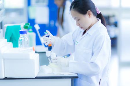 Scientist using a pipette Stock Photo