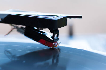 Rotating Turntable with close-up of pick-up cartridge and needle  Stock Photo