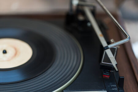 78 rpm: Rotating Turntable with close-up of pick-up cartridge and needle  Stock Photo