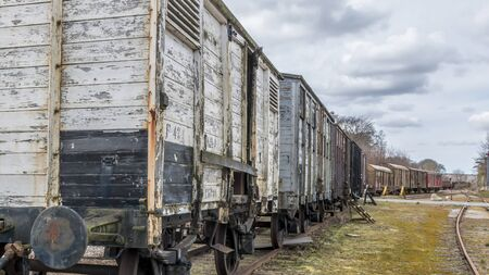 Old train carriages on rails, Red and white wooden train carriages