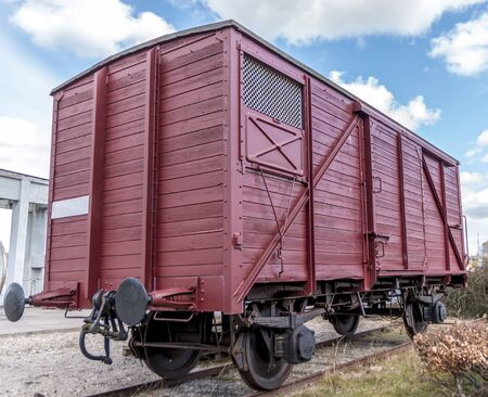 Old train carriage on rails, Red wooden train carriage