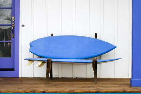 repurpose: A playful surfboard bench on a porch in Colorado