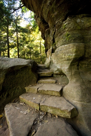between: A stone stairway in the forest, leading the way Stock Photo