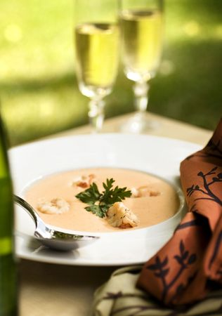 A romantic outdoor meal with lobster bisque and champagne Stock Photo