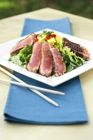 A gourmet tuna salad with citrus salsa