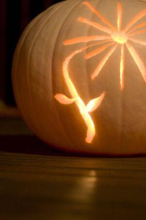 innards: A flower carved into a white pumpkin with orange innards