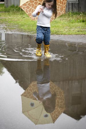 A fun day with a 4-year-old and adorable rain accessories.  Stock Photo