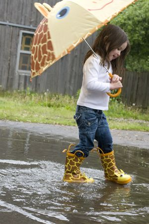 A fun day with a 4-year-old and adorable rain accessories. Stock Photo - 6489716