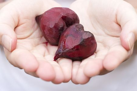 Two beet hearts in the palm