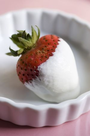 Strawberry dipped in whipped cream Stock Photo