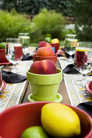 Outdoor place setting with peach centerpieces