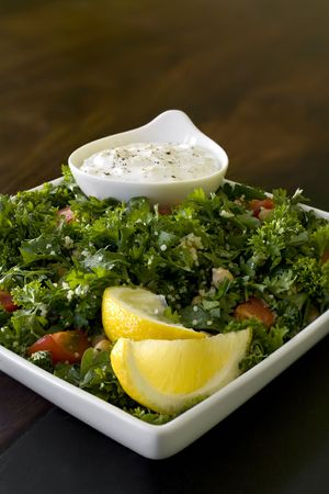 tzatziki: Tabouli salad with tzatziki sauce Stock Photo