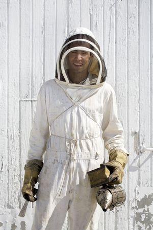 Beekeeper in hooded suit Stock Photo - 6530102