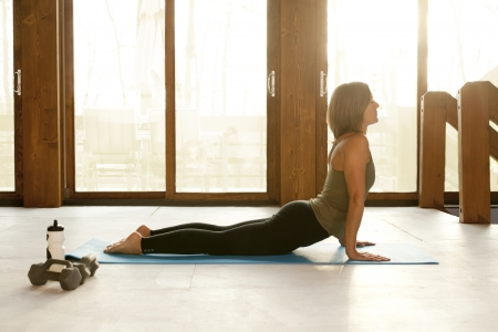 home trainer: Woman Doing Yoga