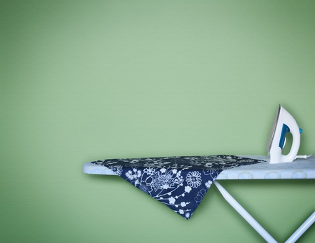 Iron on Ironing Board Stock Photo