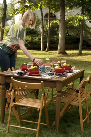 entertain: Woman Setting Table for Outdoor Dinner Party