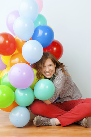 big women: Woman Hugging Balloons Stock Photo