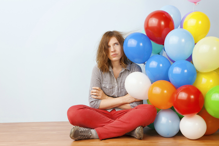 light duty: Annoyed Woman Holding Balloons Stock Photo