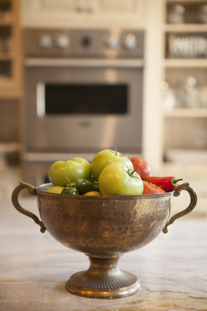 double oven: bowl of vegetables in a modern kitchen Stock Photo