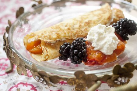 french fancy: Crepe with whipped cream, blackberries and peaches Stock Photo